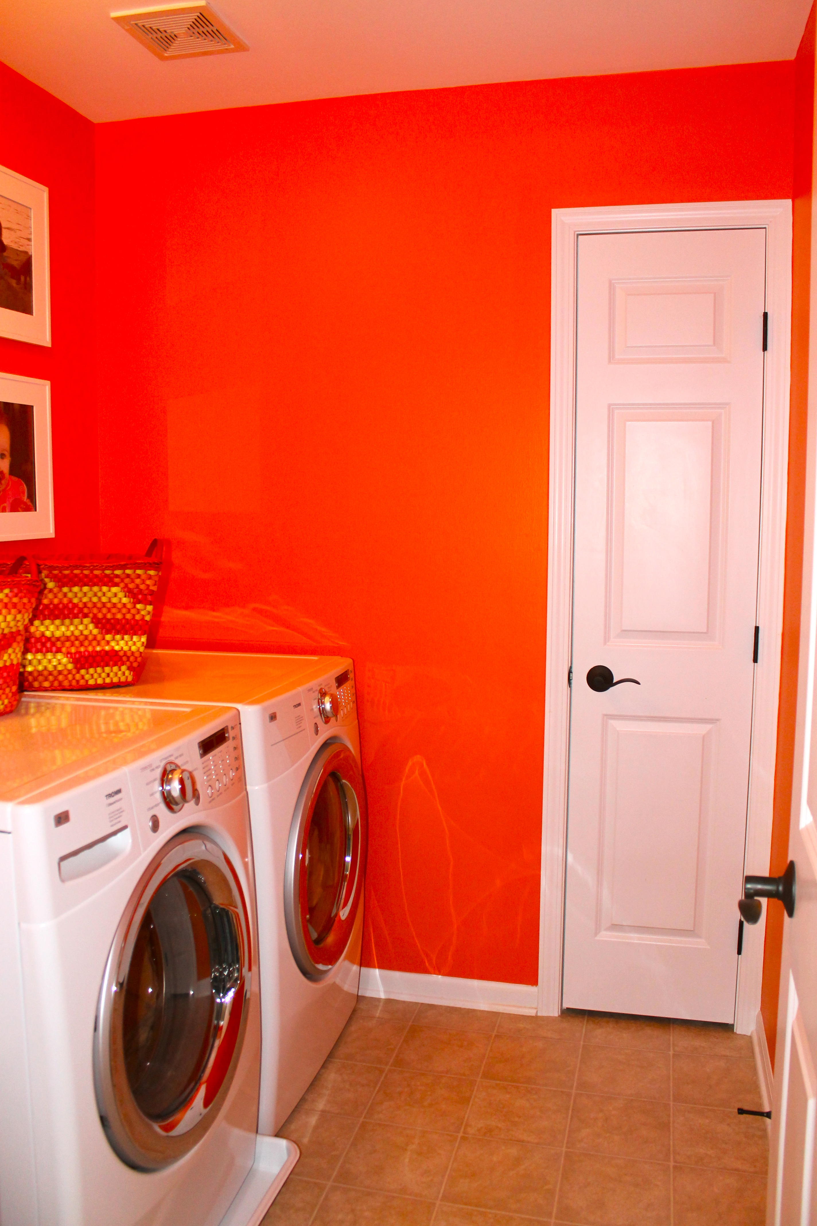 Bright Orange Paint mae's laundry room | bring mae flowers