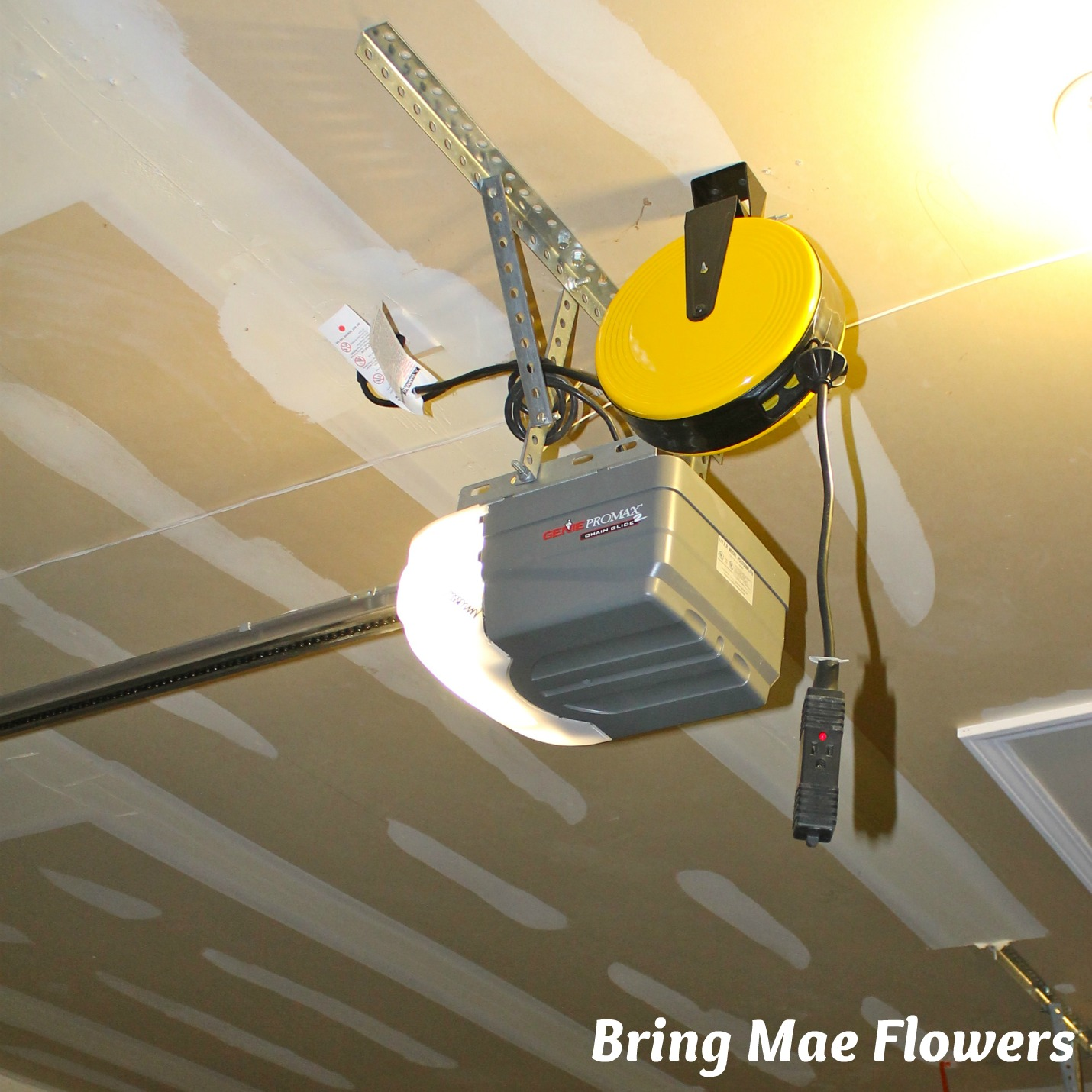 Garage door opener outlet - It S A Great Way To Make Use Of That Extra Power Outlet We All Have In Our Garages Where Our Overhead Garage Door Openers